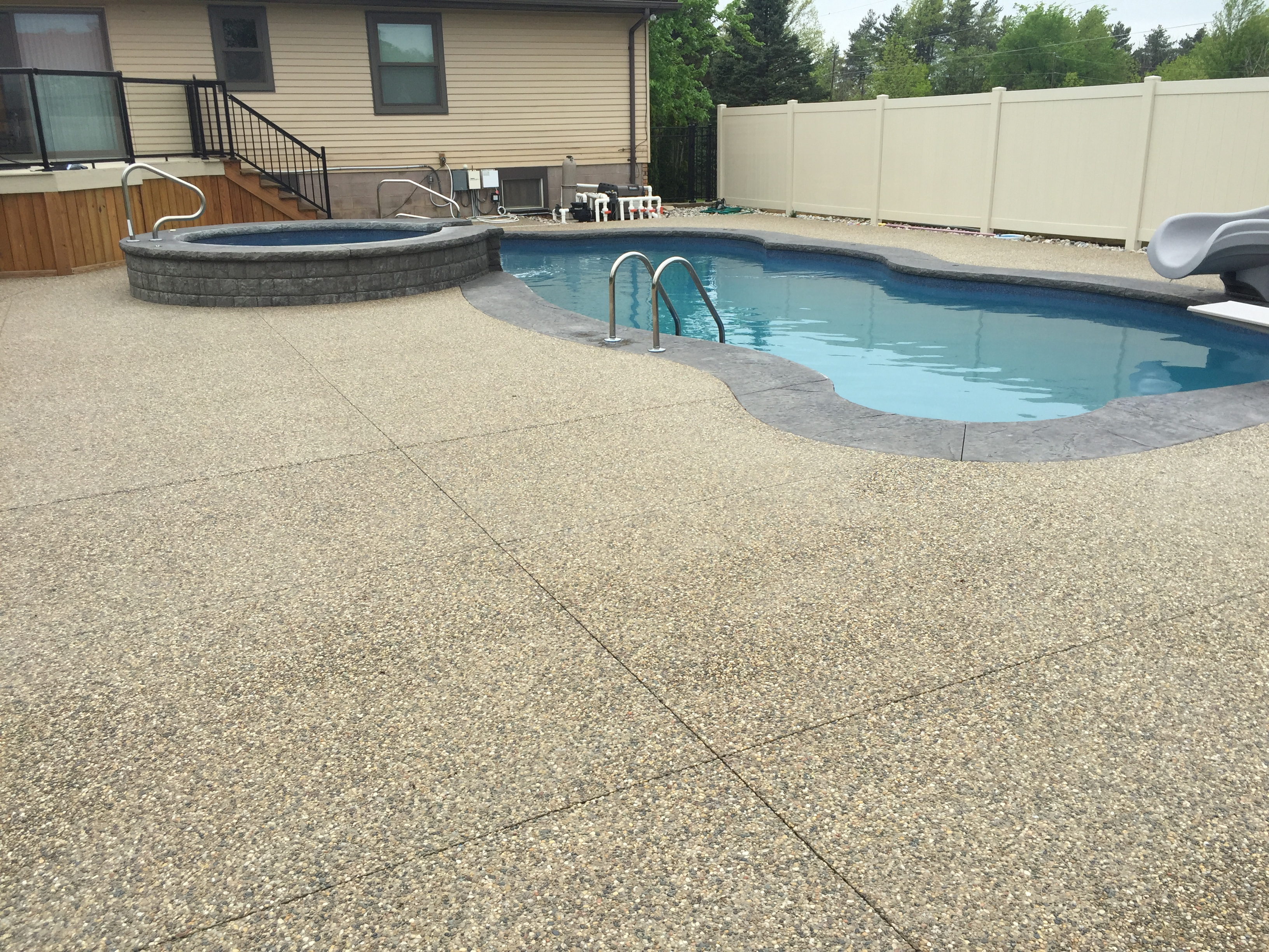Macomb Twp Exposed Aggregate Sealing The Concrete Doctor